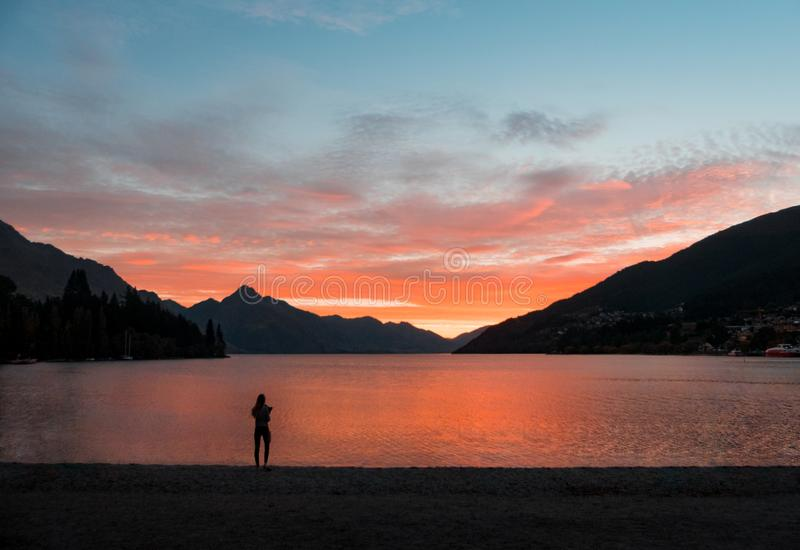 Silhouette Photo of Person Standing Near Body of Water royalty free stock image