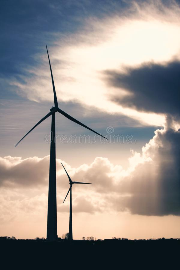 Silhouette Photo of Two Wind Mills during Golden Hour stock image