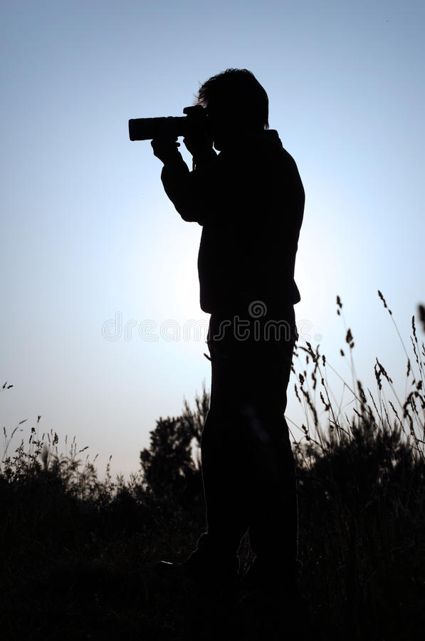 Download Silhouette Of A Photographer Stock Photo - Image of contour, outside: 9723422