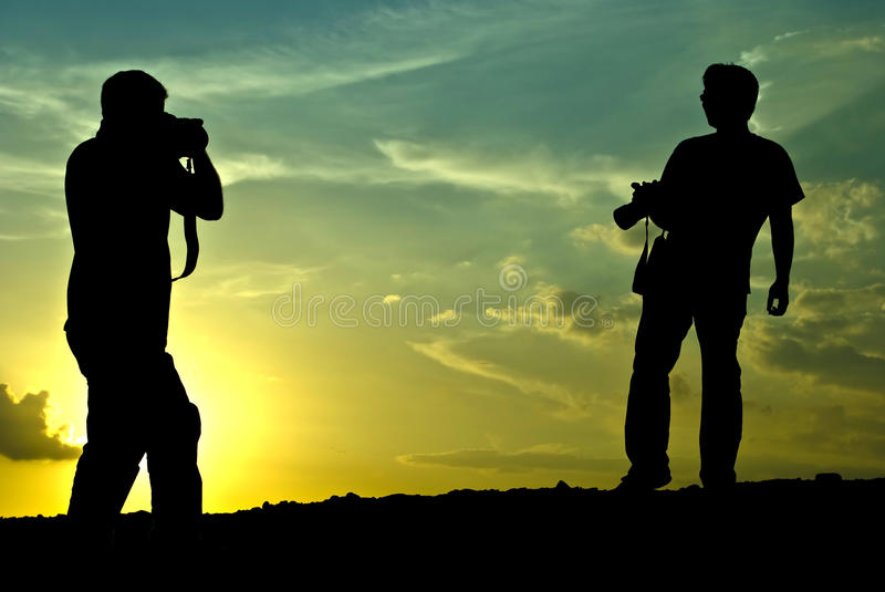 Silhouette: The photographer photographed stock photography
