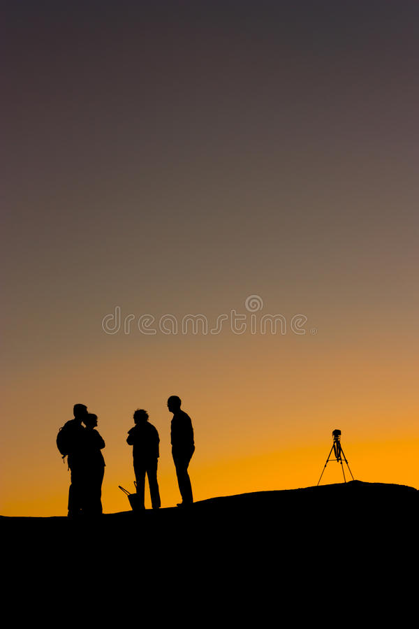 Silhouette Of A Photographer At Sunset Royalty Free Stock Photos