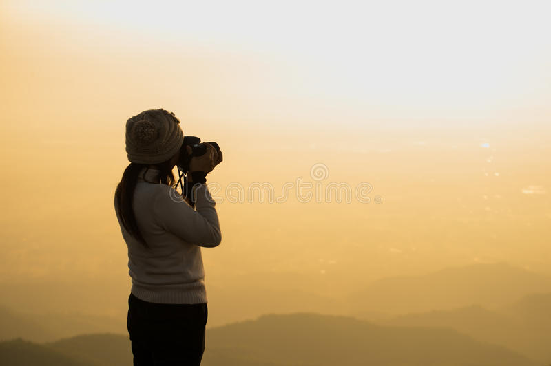 Silhouette of photographer taking picture stock photography