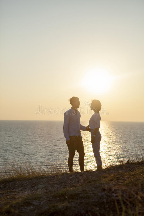 Silhouette photography of couples younger man and woman standing royalty free stock photography