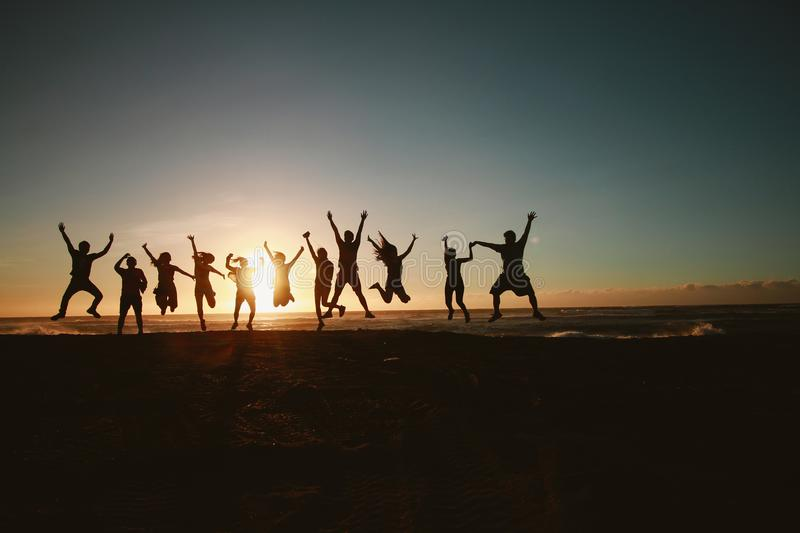 Silhouette Photography of Group of People Jumping during Golden Time royalty free stock photos