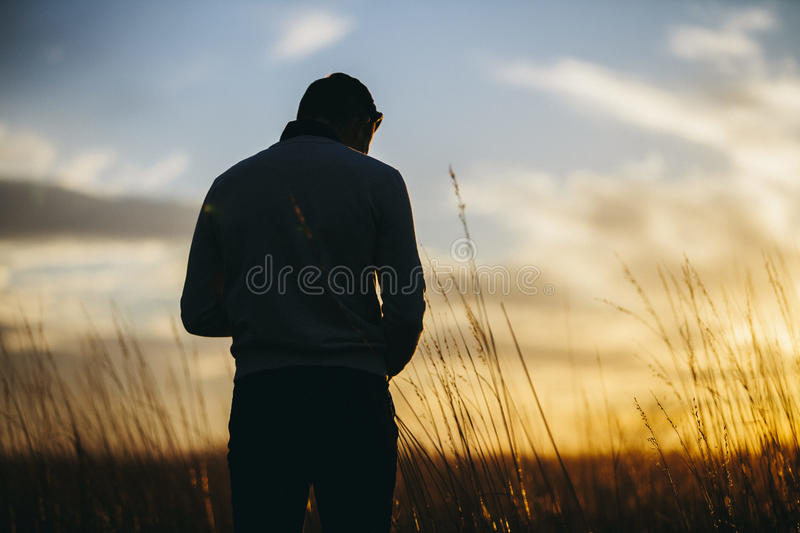 Silhouette Photography Of A Man Standing And Bow Down Head Free Public Domain Cc0 Image