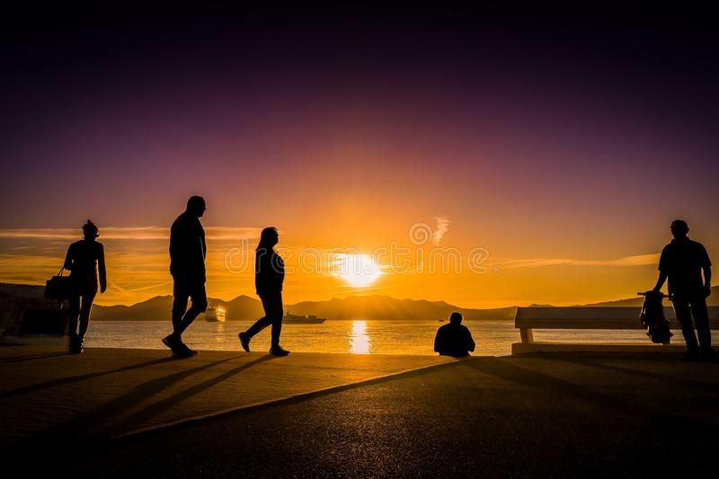 Silhouette Photography of People Near Body of Water royalty free stock photo