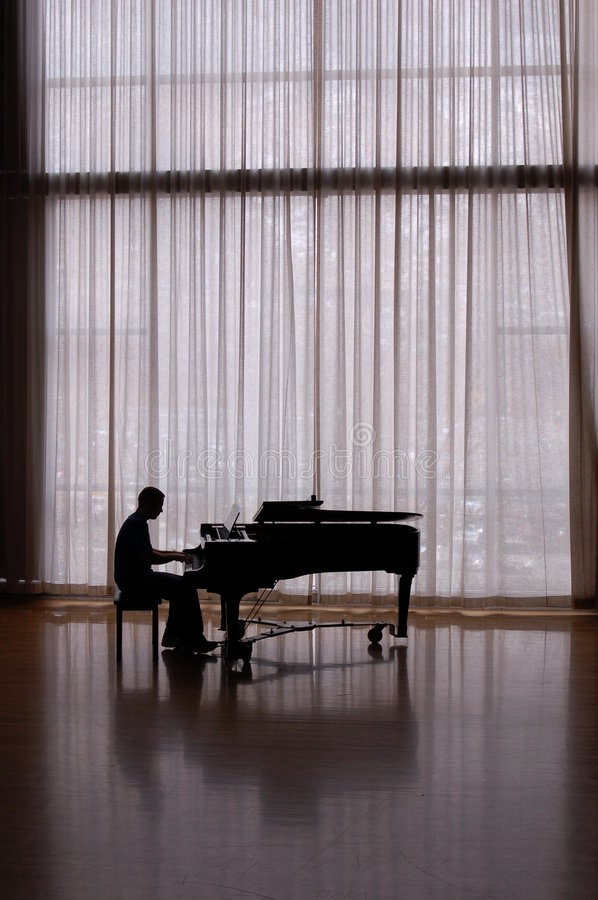 Silhouette pianist stock images
