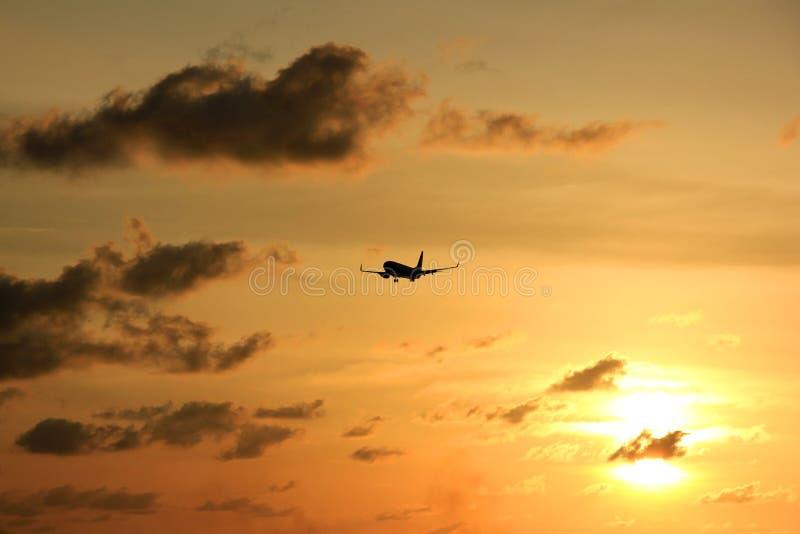 Silhouette plane at sunset Sunset in Maron Beach, Semarang, Indonesia.  stock photo