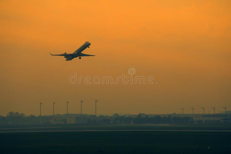 Silhouette of plane taking off, orange sky. Silhouette of plane taking off, orange sunset. Airport background stock photography