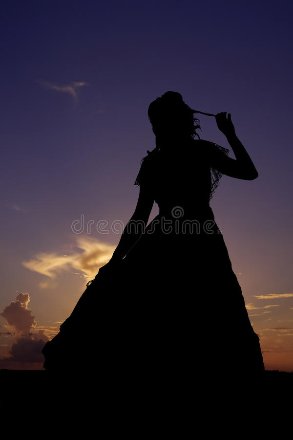 Silhouette playing with hair royalty free stock image