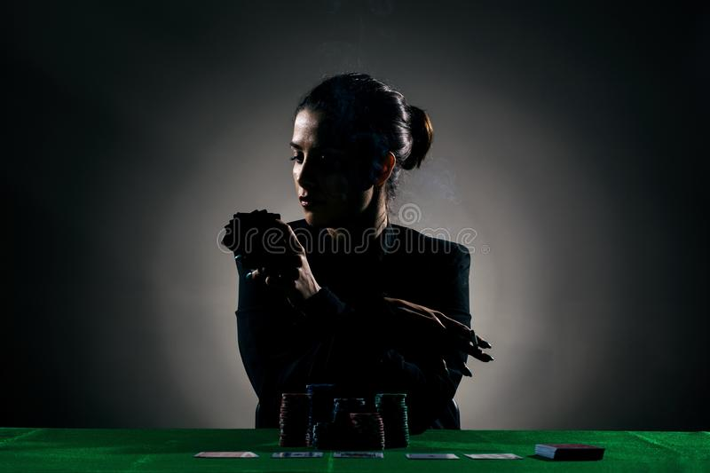 silhouette poker girl with a cigar stock images