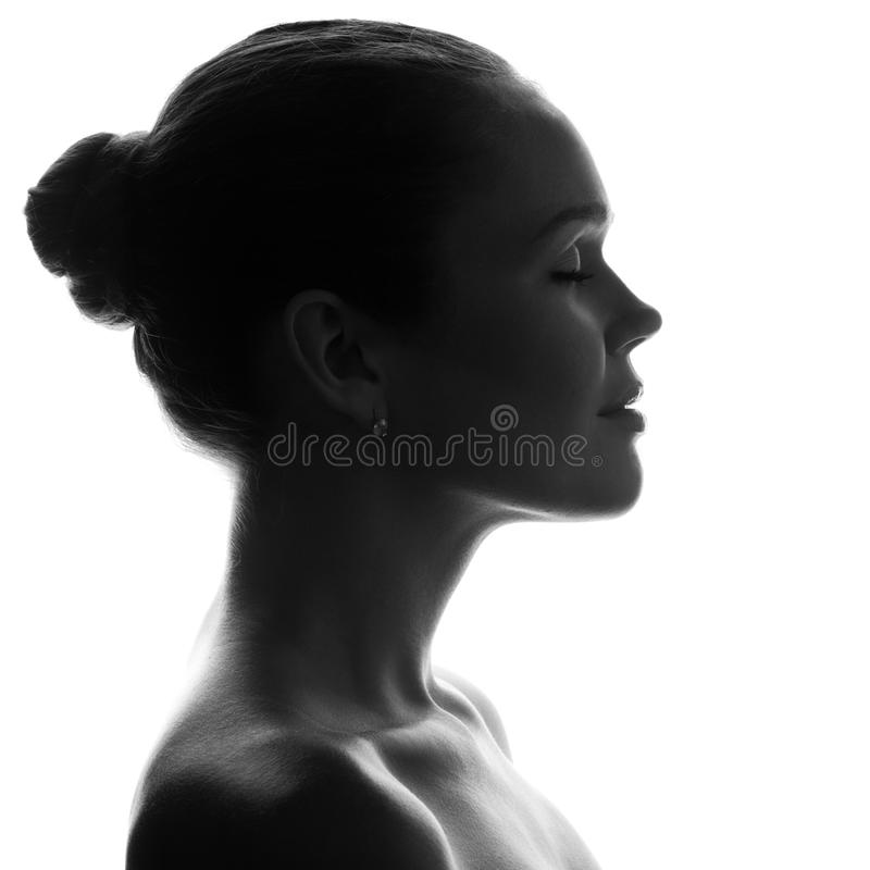 Silhouette of pretty woman stock images