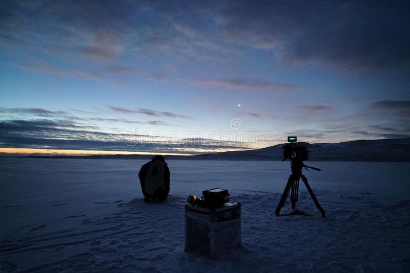 Silhouette of professional video operator in desert of Yamal at sunset. Silhouette of professional video operator in desert of Yamal at sunset stock photography