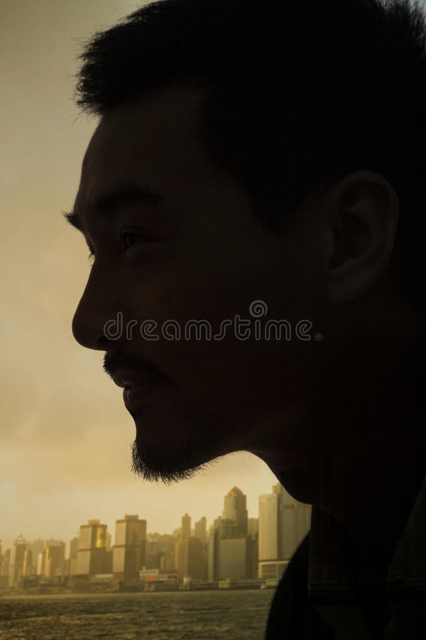 Silhouette and profile of young man, close-up on face, studio shot stock photos