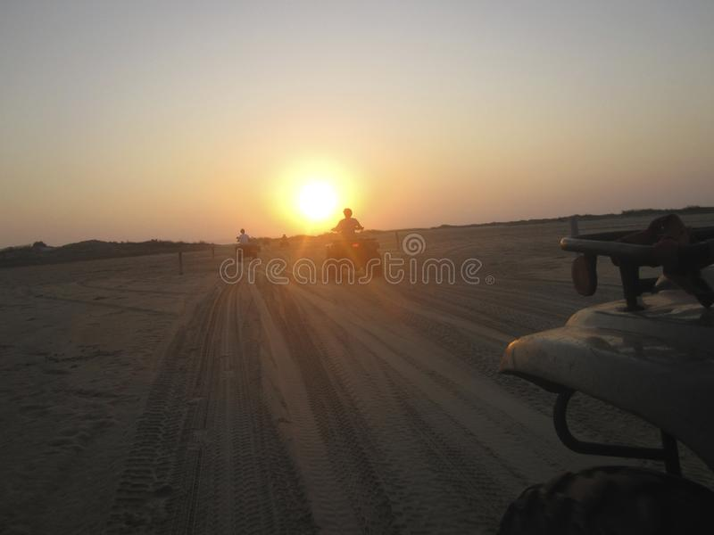 Silhoette of quad bike rider on a beach in Mozambique stock image