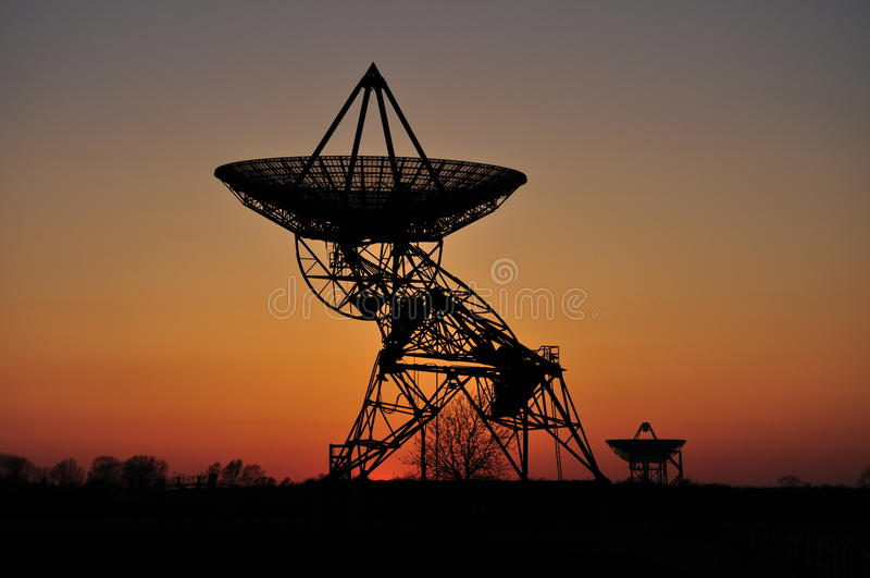 Silhouette of radar dishes stock photography