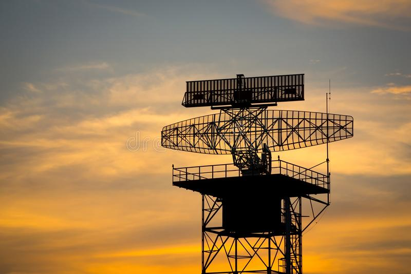 Silhouette radar tower plane and twilight sky royalty free stock photography