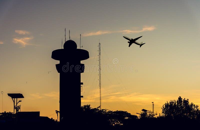 silhouette radar tower on Sunset sky. stock photos