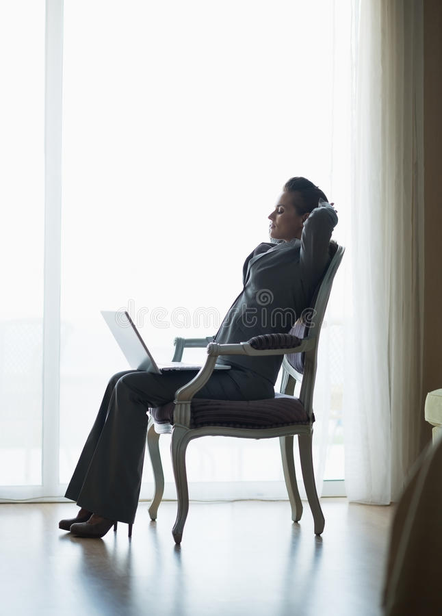 Silhouette Of Relaxed Business Woman In Hotel Room Royalty Free Stock Image
