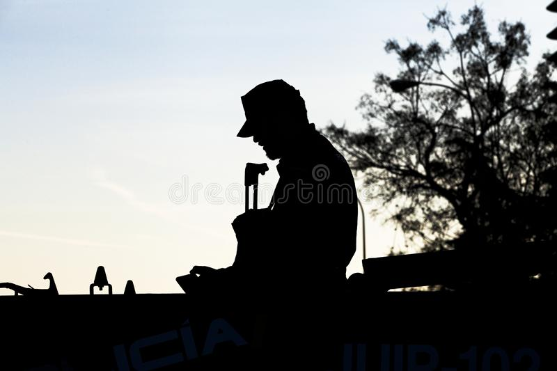 Silhouette of riot police stock photos
