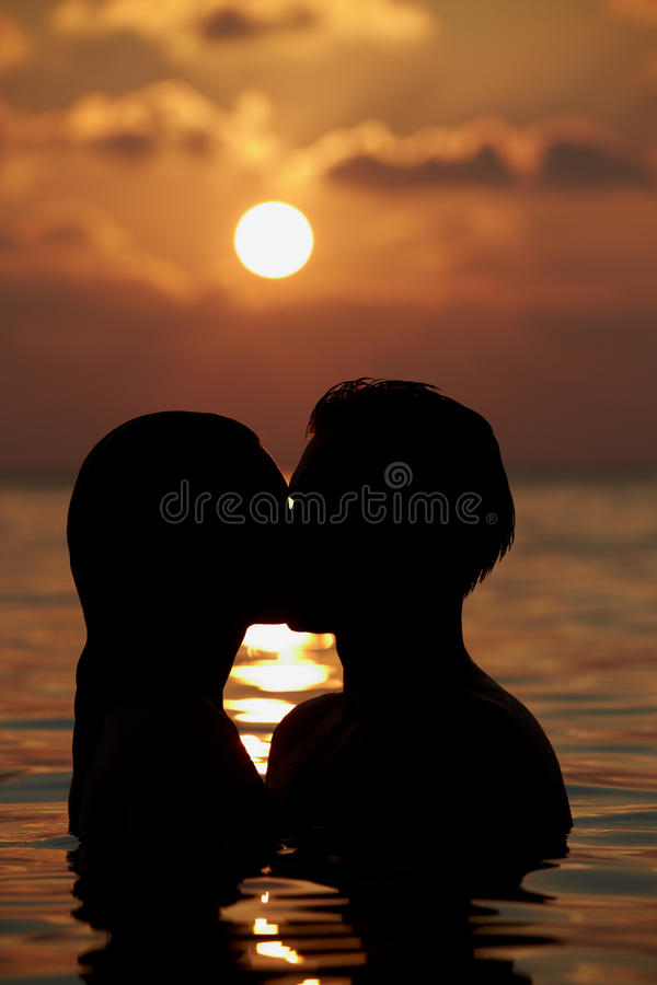 Download Silhouette Of Romantic Couple Standing In Sea Stock Image - Image: 30235121