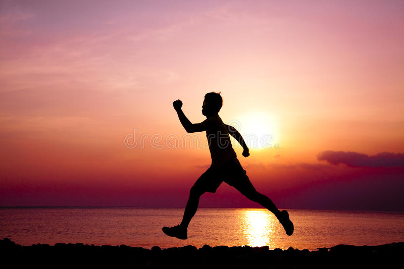 The Silhouette of runner stock photos