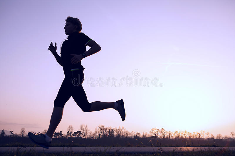 Silhouette runner in sunset rise royalty free stock image