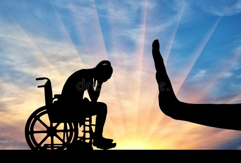 Silhouette of sad disabled woman in wheelchair and hand gesture stop stock photography