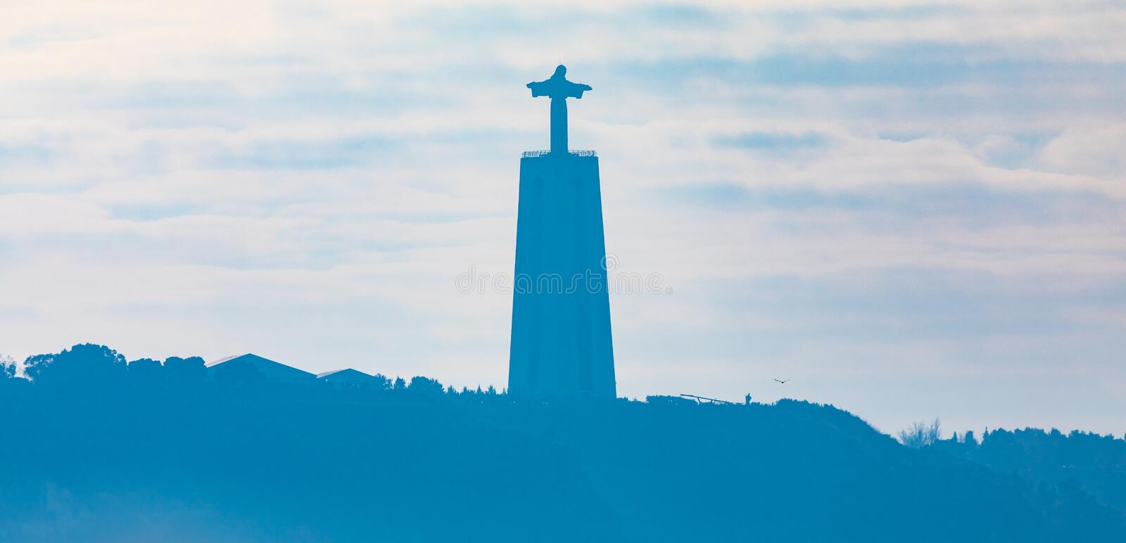 Silhouette of The Sanctuary of Christ the King in Almada in Portugal. Catholic monument and shrine dedicated to the Sacred Heart of Jesus Christ overlooking the royalty free stock images