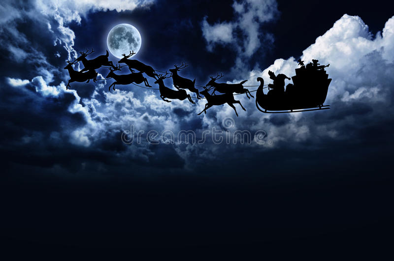 Silhouette of santa sleigh & reindeer in night sky royalty free illustration