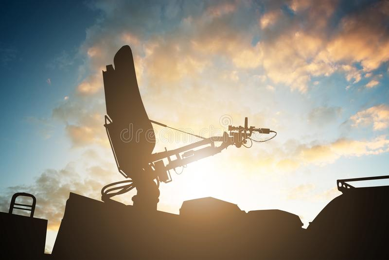 Silhouette Of Satellite Dish Antenna On Top TV Van royalty free stock image