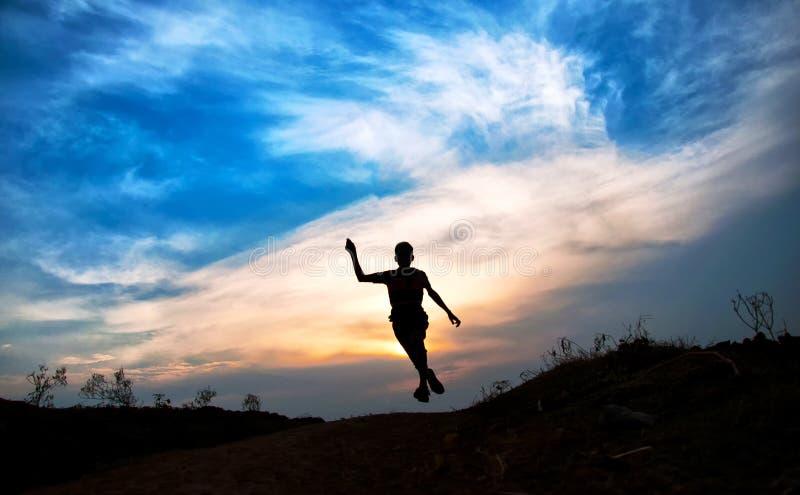 Download Silhouette sautante image stock. Image du amusement, lifestyle - 45356553
