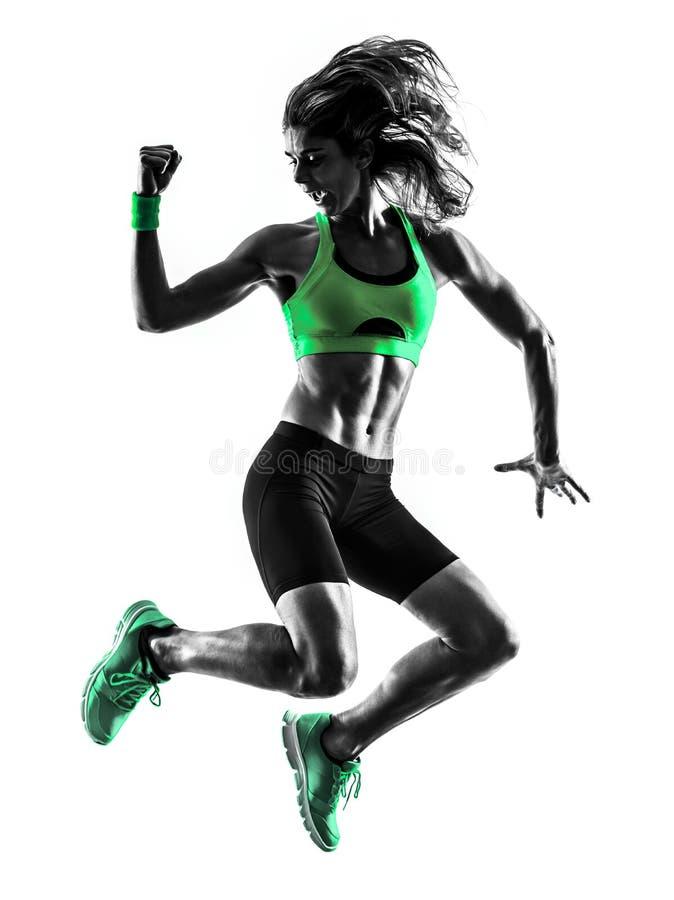 Silhouette sautante d'exercices de forme physique de femme photographie stock libre de droits