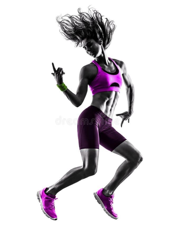 Silhouette sautante d'exercices de forme physique de femme photo stock