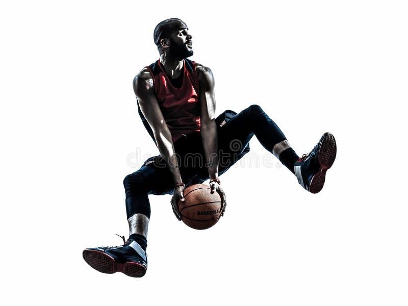 Silhouette sautante de joueur de basket africain d'homme photographie stock libre de droits