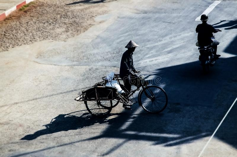 Silhouette scene of old-fashion cycle rickshaw and motorcycle, stock photography