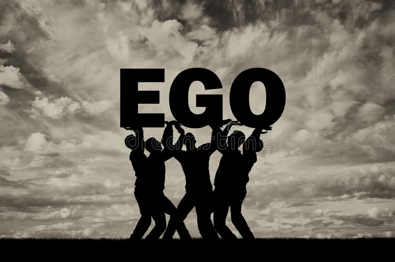 The silhouette of a selfish crowd holds the word ego stock image