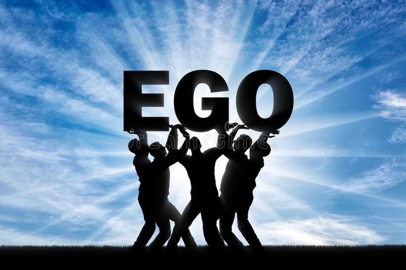 The silhouette of a selfish crowd holds the word ego. stock photos
