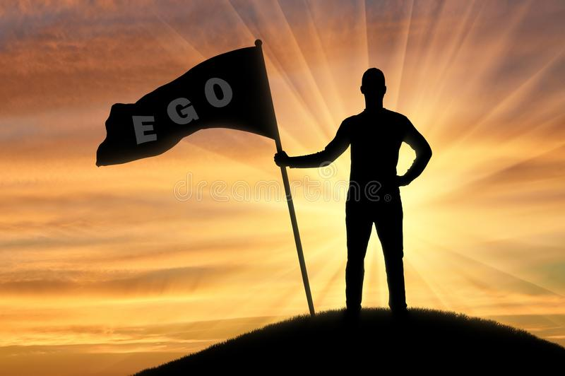 Silhouette of a selfish man with a crown on his head holds a flag with the word ego on top of a hill stock images