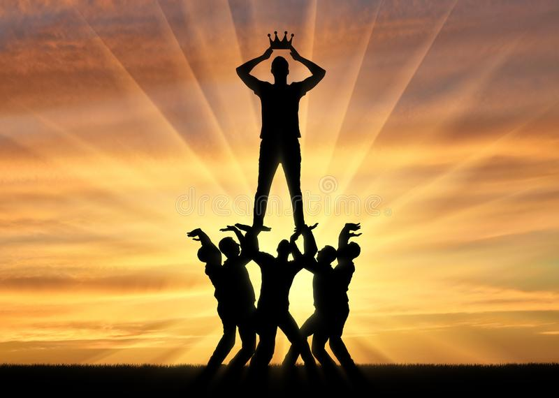 Silhouette of a selfish and narcissistic man dressing a crown, he stands on a crowd of men royalty free stock photography