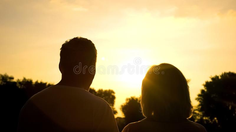 Silhouette of senior couple watching sunset together, secure old age, well-being. Stock photo royalty free stock photos