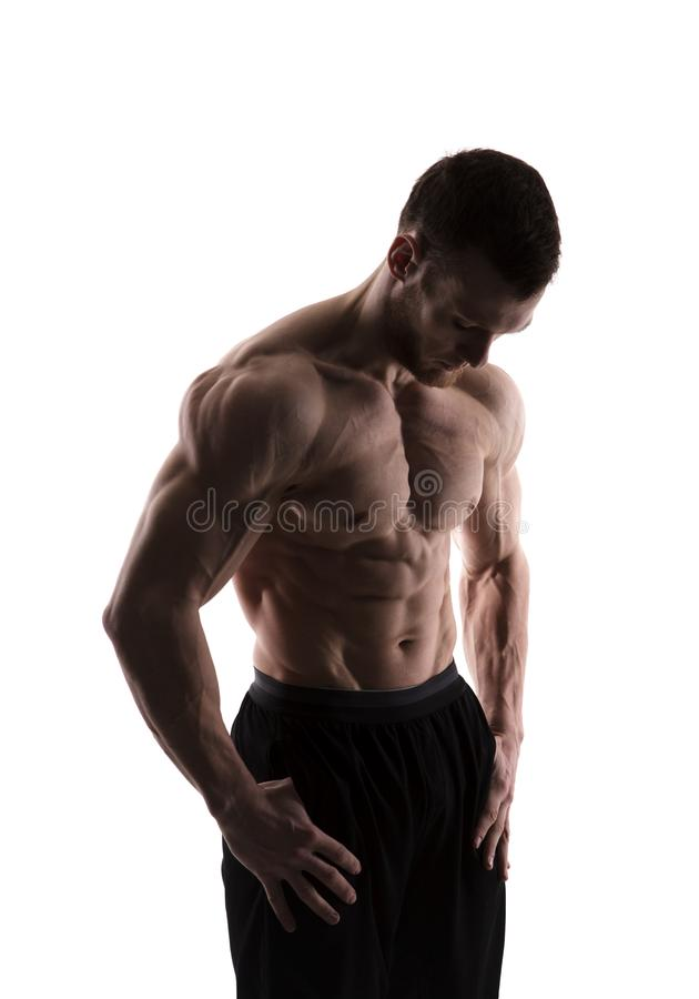 Silhouette of a bodybuilder on a white background stock images