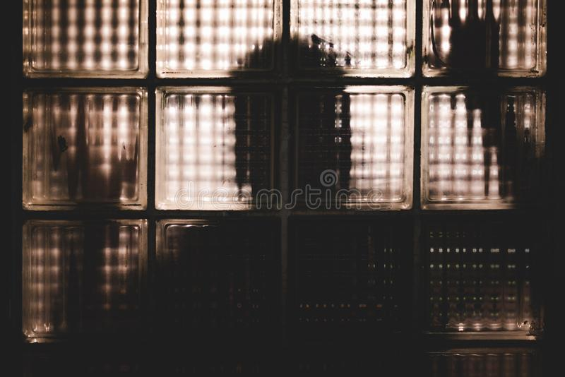 Silhouette of shadow like man shape behind the mirror. Ghost and scary concept. Maniac and psychosis concept. Haunt and horror stock photo