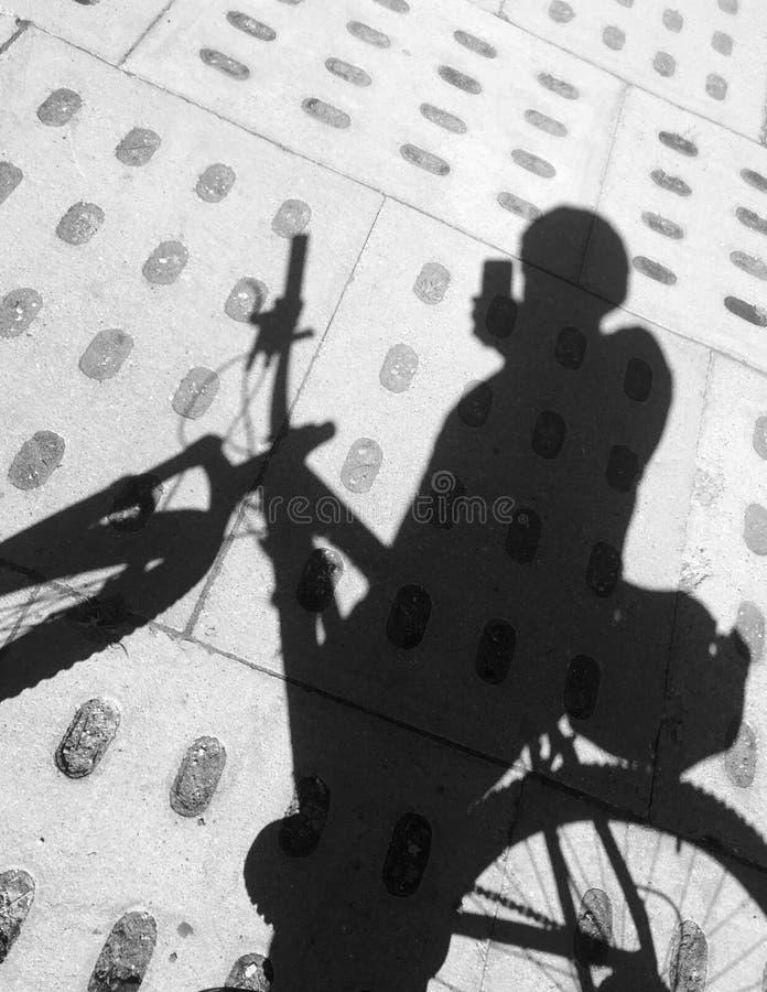 Cyclist tourist selfie shadow on paved path stock photos