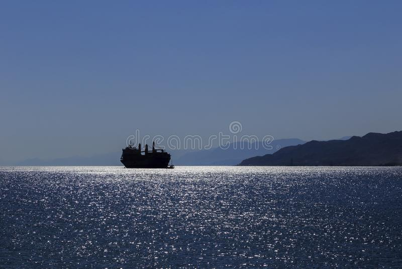 Silhouette of a ship in the Gulf of Aqaba of the Red Sea stock photos