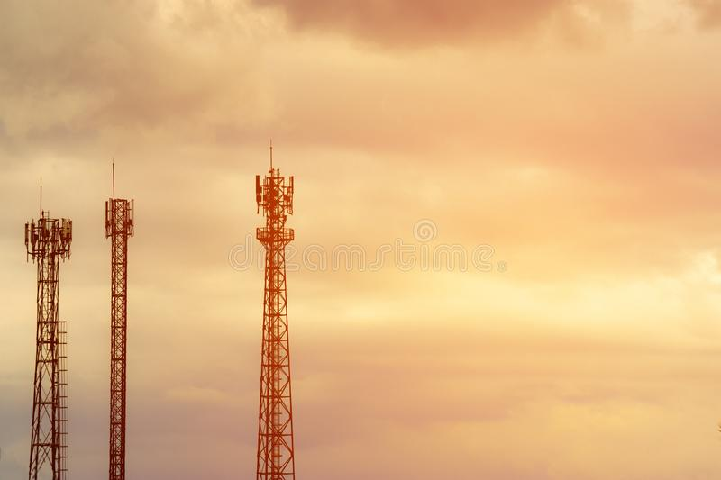 Silhouette signal antenna tower at sunset sky background. Silhouette the mobile communication antennas in evening sky royalty free stock image