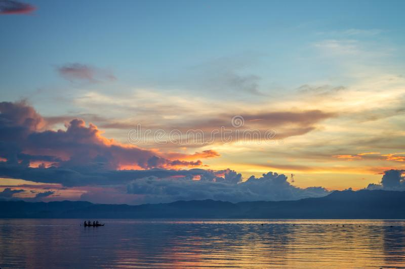 Silhouette of a small boat on the ocean at sunset, Cebu island, the Philippines. Silhouette of a small boat on the ocean at sunset, Cebu island in the stock photo