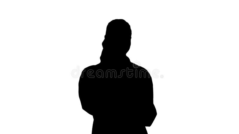 Silhouette Smiling female doctor on the phone talking while walking. royalty free stock photos