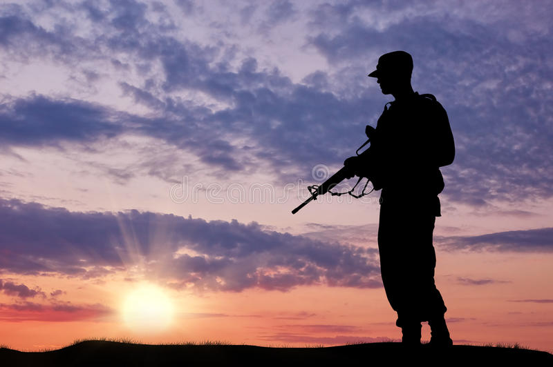 Silhouette of soldier with a gun royalty free stock image
