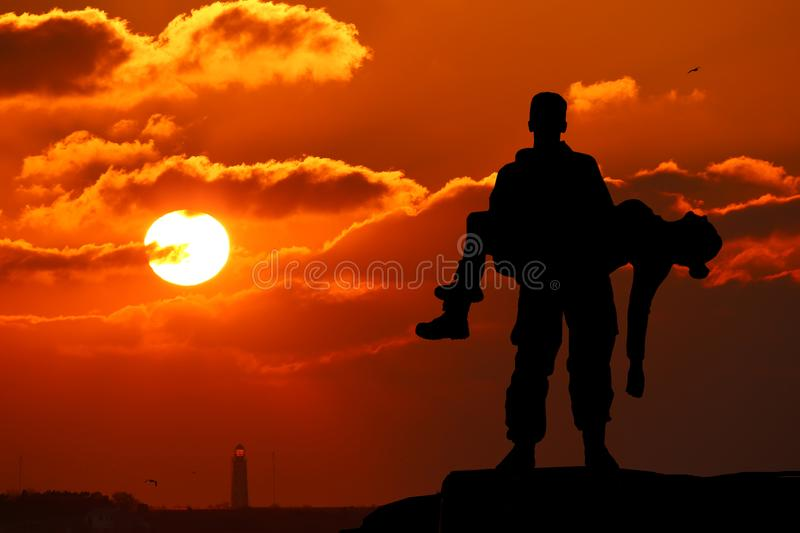 silhouette of a soldier officer man holding on hands girl woman stock photo